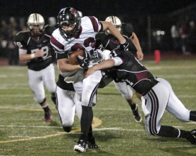 by: DAN BROOD POWER RUNNING — Tualatin junior Jeffrey Williams looks to power his way past the Glencoe defense in last week's game. The Timberwolves won 44-7.