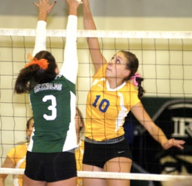 by: David Ball Barlow's Meg Marlett goes for a kill against Reynolds blocker Tatiana Ofa during the Bruins' five-set victory Thursday night.