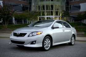 by: Courtesy of Toyota Motors Caption: Stylish body moldings help dress up the S version of the 2011 Toyota Corolla.