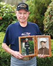 by: Shanda Tice World War II veteran Floyd Kirby shows off a set of photos of himself as a young man in uniform, right, and then a more recent shot of him in uniform. Kirby recently won a trip from the Honor Flight Network to visit Washington, D.C.