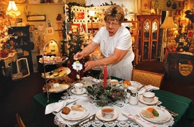 by: Shanda Tice Country Romance owner Evelyn Bennier presents a sample of her upcoming Christmas High Tea, Friday and Saturday, Dec. 9-10, at her tea room and craft shop in Boring where she sells holiday decorations and vintage gifts.