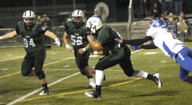 by: DAN BROOD END-ZONE BOUND – Tigard junior Zach Floyd, with sophomore tight end Jake Biglow (84) and senior guard Ethan Lange (52) out in front, is on his way to a 23-yard touchdown run.