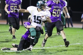 by: Chase Allgood Gaston running back Kevin Reynolds (15) drags a Portland Christian defender for extra yardage during Friday's Northwest League football game.