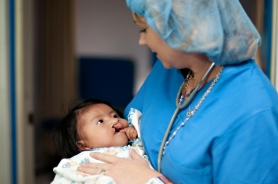 by: Submitted photo Nurse Tammy Berks holds a patient in Peru before a cleft lip and palate surgery.
