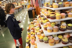 by: Vern Uyetake Joe Fitzpatrick carefully considers his cupcake selection at a preview of Fred Meyer's grand reopening.