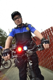 by: VERN UYETAKE Officer Ryan Lesmeister flashes the lights on his bike. The bikes are also equipped with sirens.