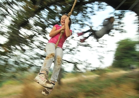 by: VERN UYETAKE Carmel Corrigan, a fourth-grader at Willamette Primary School, took to a rope swing during an outing last week in the White Oak Savanna.