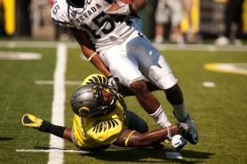 by: CHRISTOPHER ONSTOTT University of Oregon linebacker Michael Clay makes a tackle behind the line of scrimmage against Nevada. The Ducks' defense has been good most of the season, but a stretch of tough tests are still ahead.