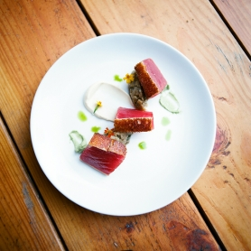 by: CHRISTOPHER ONSTOTT Central is a classy cocktail bar-turned-restaurant on Southwest Ankeny offering plates such as the ahi tuna, which is wrapped in brioche and arranged on a trio of purees.