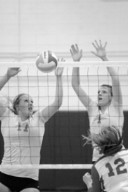 by: MATTHEW SHERMAN West Linn's Caroline MacAusland and Caitlin O'Neil go up for a block in last week's five-set loss to Lake Oswego.