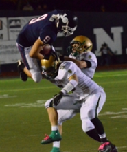 by: VERN UYETAKE Zach Walen is upended by a West Linn tackler in last Friday's game. Walen had an interception return for a touchdown for the team's final score.