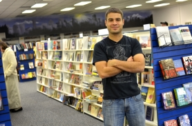 by: Jessie Kirk Randy Eljimal manages Tigard's Dollar Book Fair, a new bookstore that offers more than 50,000 books for $1 and $2 each. The variety of books at the store depend on the day and often include bestsellers and popular titles.