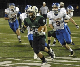 by: DAN BROOD INTO THE CLEAR – Tigard junior running back Benny Wick sprints into the open field during the Tigers' Pacific Conference game with Newberg on Friday. Tigard gave the homecoming crowd a 51-14 victory.