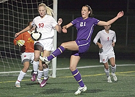 by: Miles Vance METRO BATTLE — Westview's Jill Thomas (left) and Sunset's Taylor Coon spar during the Wildcats' 1-0 home win on Monday.