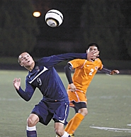 by: Miles Vance FOCUSED — Westview senior forward Jaime Velasco gets ready to make a header while chased by Beaverton senior defender Arturo Vargas during the Beavers' 1-0 win at Beaverton High School on Oct. 20.