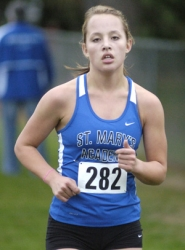 by: David Ball St. Mary's sophomore Paige Rice spent pretty much the entire race out alone in first place, as repeat district champion in the Mount Hood Conference.
