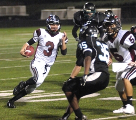 by: DAN BROOD TRAVIS TERRIFIC — Tualatin senior quarterback Travis Johnson (3) is on his way to the end zone in the fourth quarter of Friday's game. Johnson had two TD runs and a TD pass in the Wolves' 35-21 win over Century.