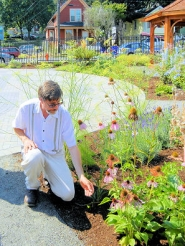 by: Elizabeth Ussher Groff Woodstock resident Dr. Glen Nagel points out coneflower/echinacea, while giving a tour of the new Min Zidell Healing Garden. The labyrinth, pavilion, plus more herbs and some ornamentals, can be seen in the background.