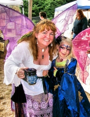 "by: Rita A. Leonard Two fairies pose for the camera during the ""Pagan Pride Festival"", on September 18th at Oaks Amusement Park."