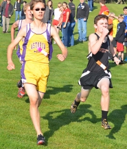 by: John Brewington WINNING MOVE—Scappoose's Tyler Wills nipped two Astoria runners just before the finish line and that's what it took to give Scappoose the boys district title.