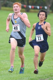 by: John Brewington  CLOSE FINISH—St. Helens Ryan Byrd edged longtime rival Aki Kitagawa for first place at the NWOC district cross country meet Wednesday at Blue Lake.