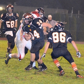 by: John Brewington  RUNNING HARD–Scappoose's Grayson Schillereff picks up big yards during Friday's game with Seaside.