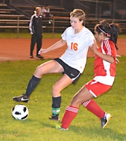 by: John Brewington IN CONTROL—Scappoose's Kate Collard keeps the ball away from Seaside defender during last Wednesday's match. Scappoose beat Seaside 3-0 to clinch the Cowapa League championship.