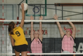 by: Kris Anderson Sandy's Allie Haris (3) and Breanna Creech (11) jump to block a St. Helens spike during last Thursday's 3-1 loss.