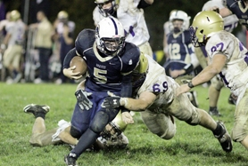 by: Chase Allgood Banks running back Dakota Kemper (5) runs through the tackle of Astoria's Tony Rudolfi during Friday's Cowapa League football game.