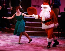 "by: Craig Mitchelldyer Amy Beth Frankel and ""Santa"" have a great time dancing together in the Broadway Rose Theatre Company's holiday show, ""A Very Merry PDX-MAS."""