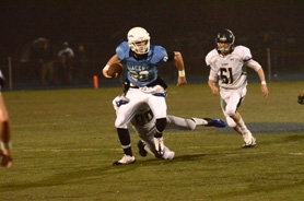 by: VERN UYETAKE Lakeridge's Brandon Loiler tries to escape a tackle in last week's loss to Canby.