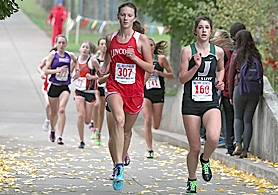 by: Miles Vance LEADERS OF THE PACK — Lincoln's Claire DeVoe and Jesuit's Adrienne Demaree race to a 1-2 finish at district on Oct. 26 at Tualatin Hills.