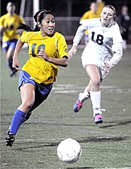 by: Matt Sherman WINNERS — Aloha's Linda Nguyen makes a run down the the sideline in her team's 3-1 loss to West Linn in their Class 6A Play-In game on Tuesday.