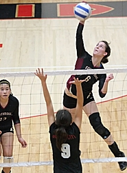 by: Miles Vance G-L-O-R-I-A — Southridge's Gloria Valusek connects for a kill against Oregon City on Saturday.