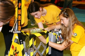 by: Jason Marr These ladies were all business as they prepared their robot to compete in the second annual Girls Generation event.