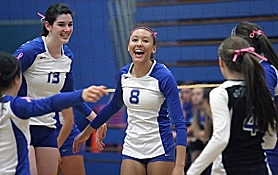 by: Miles Vance WE WIN — Aloha senior Jasmine Osborne (center) celebrates with her teammates after the Warriors beat McNary in the first round of the Class 6A state playoffs on Nov. 2.