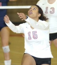 by: David Ball Mt. Hood's Alyssa Hall chases a ball into the back row during Friday night's win.