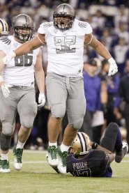 by: CHRISTOPHER ONSTOTT Oregon Ducks defensive lineman Wade Keliikipi exults over a tackle in the Washington backfield during Saturday's 34-17 UO victory at Husky Stadium.
