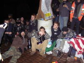 by: Courtesy of PPB Occupy Portland protesters attached themselves to a heavy barrel in Terry Schrunk Plaza on Saturday night.