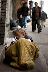 by: Christopher Onstott A man wakes on a West Burnside Street sidewalk where he had been sleeping. Portland officials are looking for more money to open homeless shelter space in the winter.
