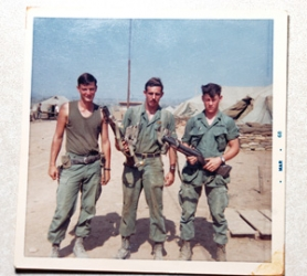 by: Contributed photo Eric Anderson is on the left in this photo with friends taken in Vietnam in 1968. Anderson regularly sent rolls of film home to his family for them to develop. Much to his father's horror, the photos sometimes contained graphic images of those killed in the war.