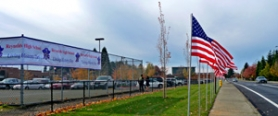 by: Tiffaney O'Dell Reynolds High School, 1698 S.W. Cherry Park Road, Troutdale, celebrates its living history day by putting up a host of flags Wednesday, Nov. 9.