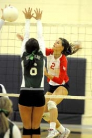 by: MATTHEW SHERMAN Lake Oswego's Madelynn Mitchell knocks a spike through a pair of Reynolds blockers in the Lakers' five-set opening-round victory last week.