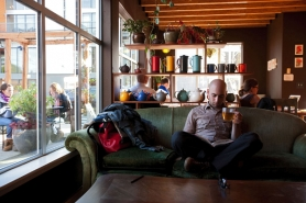 by: CHRISTOPHER ONSTOTT Jonny Grass relaxes over a cup of loose leaf tea at Townshend's Alberta Street Teahouse in Northeast Portland. The cafe is a tea retailer and wholesaler, offering 84 tea varieties as well as herbal infusions.
