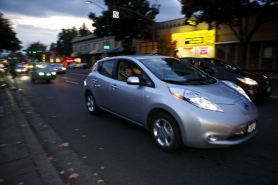 "by: JAIME VALDEZ Portland is embracing electric vehicles, as shown by this Nissan Leaf in a caravan of EVs to the opening of the documentary, ""Revenge of the Electric Cars."""