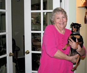 by: Polina Olsen Nancy Watts and her dog Cruiser show off a set of wheelchair-friendly French doors that replaced single doors in her Beaverton home.