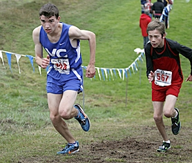 by: Jaime Valdez GOING UP — Valley Catholic's Connor Garcia (left) races to fifth at the Class 3A state meet on Saturday in Eugene.