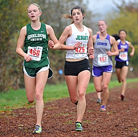 by: Zack Palmer ON THE TRAIL – Jesuit senior Adrienne Demaree (right) led her team to a third-place finish at the Class 6A state cross country meet at Eugene's Lane Community College on Saturday.