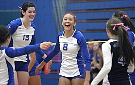 by: Miles Vance TOURNEY-BOUND – Aloha's Jasmine Osborne (center) leads her team in cheers at the end of the Warriors' Saturday win over Sheldon.