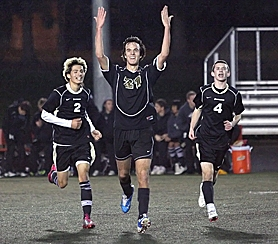 by: Miles Vance WE WIN — Southridge senior Bertrand Lambert (center, flanked by Jordan Seech and Aaron Freeman) leads the crowd in cheers after Lambert's goal on Tuesday.